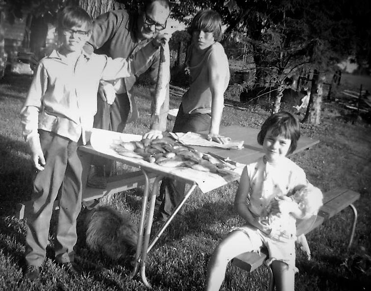 Robert holds up a fish next to his father Aldine, his brother Dean and younger sister Debbie.